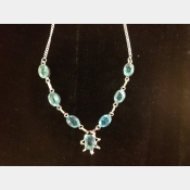Sterling seviss and blue topaz artisan crafted necklace.