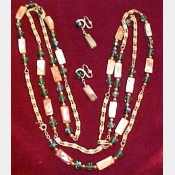 "Napier signed Vintage strand of beads 54 "" long w/matching clip earrings"